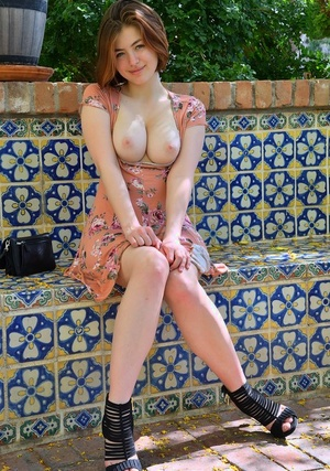 Pretty natural redhead Aria-II unclothing outdoors to flaunt her cute big tits