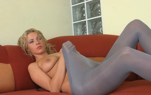 Tall blonde Dorota bares her tits before sliding opaque hose over her ass