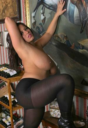 Polish solo girl Aneta Buena unleashes her huge tits in black pantyhose