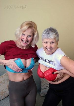 Old lesbians blow on each others breasts after modeling entirely clothed