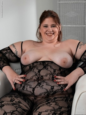 Fat solo girl toys her vagina while slipping out of crotchless bodystocking