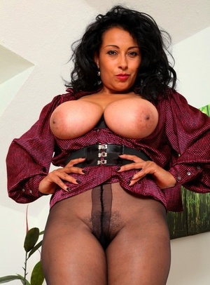 Older solo model Danica Collins shows her big tits and bush in hose and boots