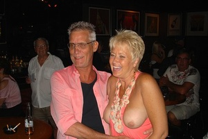 Mature swinger Tracy Lick and girlfriends seduce men at a cheap beer joint