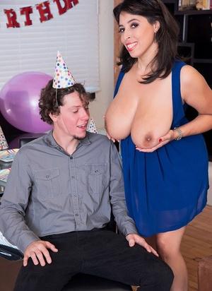 Big titted lady Elle Flynn gives the birthday boy's cock a tug