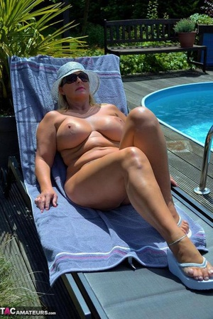Sexy mature Chrissy models hard gigantic tits & chubby nude body on and by the pool
