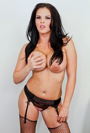 Dark haired chick Mackenzee Pierce uncups her large tits in fishnet hosiery