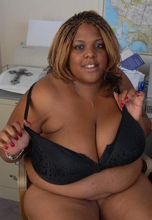 Smiling SSBBW teacher ebony Minxx is undressing in the office