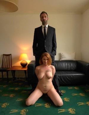 Natural redhead Princess Paris displays her big natural boobs once naked
