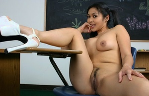 Sassy Asian teen student with hot bootie strips while the teacher is absent
