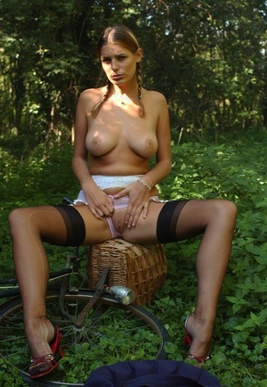 Solo model Cathy Long strips to black stockings out in the orchard