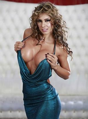 Curvy blonde cougar Esperanza Gomez unleashes big juggs from party dress