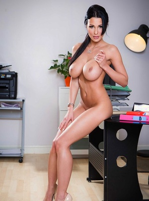 Big-titted brunette office babe Patty Michova flaunting sexy legs and stiff booty