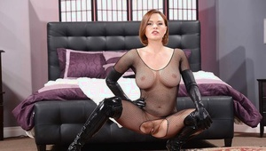 Ravishing redhead Mummy posing in provocative nylon and latex outfit