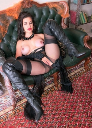 Classy female Tindra Frost shows her tits and twat in long boots and nylons