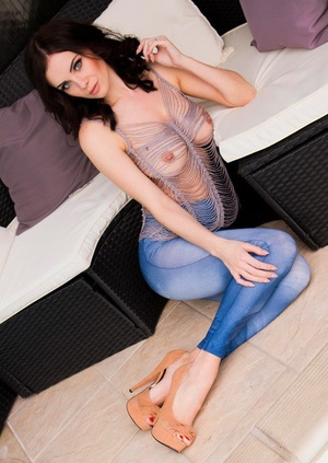 Solo model Emma Glover goes bare-breasted in tight jeans and heels