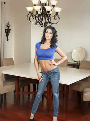 Top heavy brown-haired Peta Jensen lifts blouse to expose massive hooters