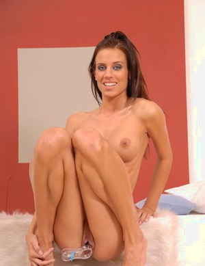 Naked solo girl Zoe inserts a speculum into her wet and puffy pussy