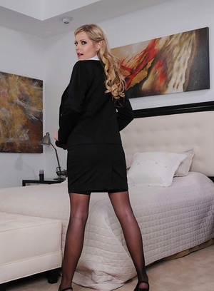 Sassy MILF in nylons and dress clothes stripping and spreading her legs
