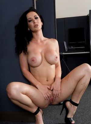 Jayden Jaymes shows off her large tits while wearing uniform in office