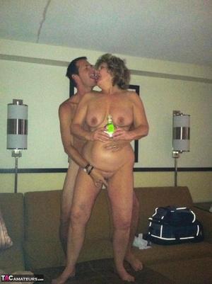 Horny granny BustyBliss oils up floppy tits & stretches slit for hotel boy toy