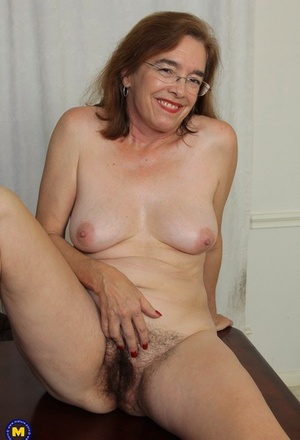 Mature American female elations her hairy bush with a vibrator