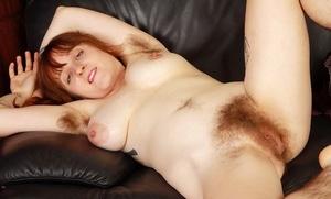 Experienced redhead Velma pulling panties aside to expose her beaver