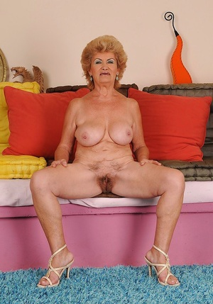 Juggy granny with ugly face undressing and expposing her shaggy slit