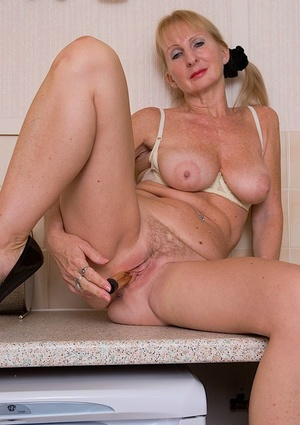 Ugly mature girl pleasing her hungry furry twat with a vibrator
