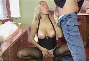 Blonde wife pulls out her big tots before providing her hubby a blowjob