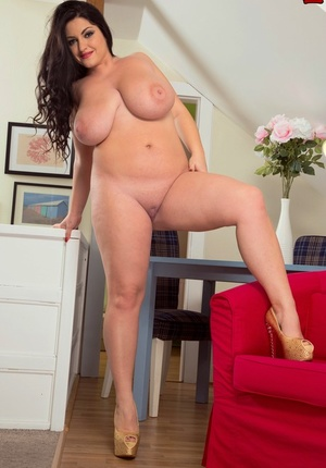 Chubby Belarusian female Juliana Simms demonstrates huge boobs and fat bottom