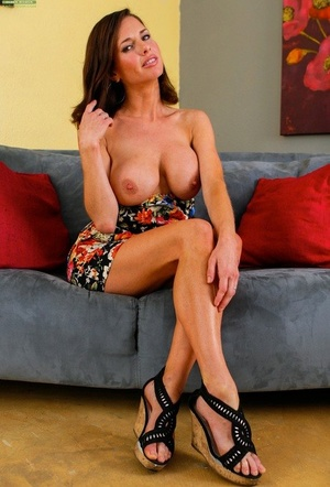 Busty wife Veronica Avluv removes her panties and massages her labia