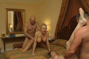 Swinging amateurs end up watching a huge-chested blonde get banged missionary style