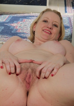 Russian wifey Anya Volcov grabs her bare ass and parts her twat with red nails