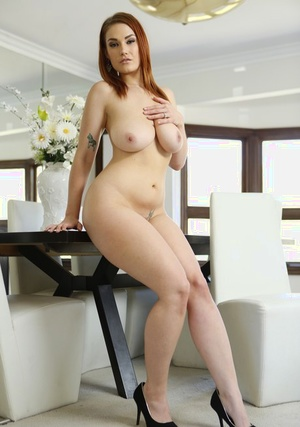Huge-boobed redhead wifey rides a man's dick after her husband eats her pussy