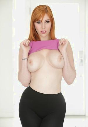 Redhead pornstar Lauren Phillips baring nice melons before shedding yoga pants