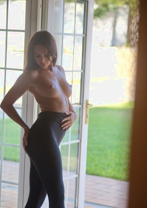 Naked girl Gina Barrett pulls on skintight riding pants with walkout door open