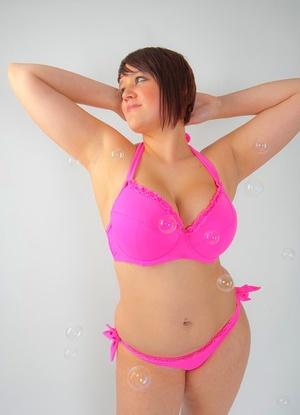 Busty molten fatty Sian blowing bubbles & slurping lollipop in sexy pinkish underwear